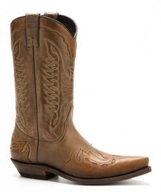 Puedes comprar en nuestra tienda online estas botas cowboy unisex Mayura en  combinación de cuero vacuno marrón   coñac y tacón cubano bajo. 68839a7d73f1b