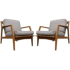 Elegant Pair of Lounge Chairs by Ib Kofod-Larsen for Selig   From a unique collection of antique and modern lounge chairs at https://www.1stdibs.com/furniture/seating/lounge-chairs/