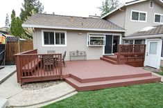Trex deck with trex railing and benches and steps (Madeira accents)