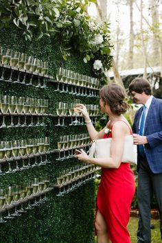 Champagne wall, Living wall, Boxwood wall, Signature drink display, Interactive cocktail hour, Garden wedding inspiration  North House Home and Garden, New Orleans wedding, NOLA wedding, Covington Louisiana wedding, The Graceful Host