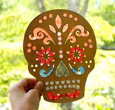 melted bead day of the dead sun catcher: 15 Day of the Dead crafts for kids via The Crafty Crow.