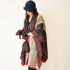 This gorgeous handwoven wool poncho is a beautiful piece for any fall/winter wardrobe.  Its 168cm long at its longest point and 115cm wide at its widest. It also has pockets at the front, for the sake of convenience.  If youd like to buy a poncho like this, just convo me! Please keep in mind that it can take up to 4weeks to make