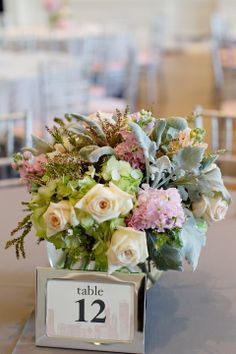 Cream Rose Pink and Green Hydrangea and Dusty Miller Reception Flowers | photography by http://www.jenlynnephotography.net/