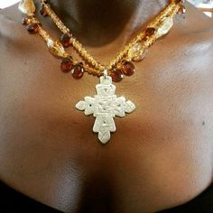 Ethiopian Coptic cross, hand made in pure sterling silver, hung with an assortment of vintage citrine beads...FB page My African Heart Jewelry