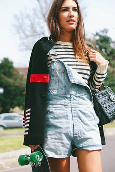 Blogger Patricia Manfield pairs stripes & Gap short denim overalls.