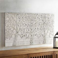 Made with bits of mirror and glass, our mosaic wall art features a row of shimmering trees that bring natural texture to your wall space. The soft, simple hues lend themselves to a variety of interior decor, while the shimmery effect delivers a touch of modern drama.