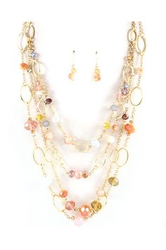 This necklace would look gorgeous with a white shirt and jean capris!!!:)