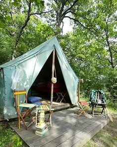 Camp Wandawega. #splendidsummer  We have spent a lot of time in the woods in a tent like this!  Fond memories, kids and a wet Newfoundland.  Bear loved the wood so much too!