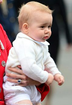 Full of energy, held securely in his mother's arms, Prince George seemed unfazed by their 30 hour flight and looked eager to be on firm ground