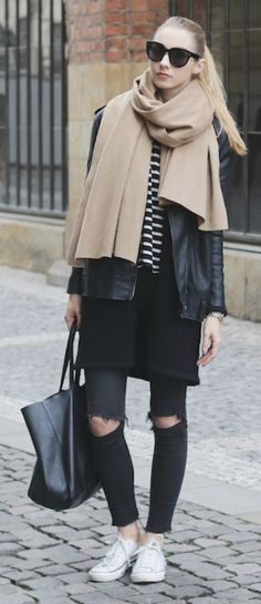 Pavlína Jágrová wears the oversized scarf trend with a leather jacket and white converse.   Top/Jeans: Mango, Sweater: Lindex, Jacket: H&M, Shoes: Converse.
