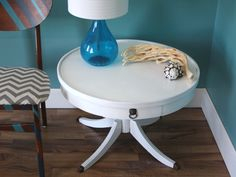 Vintage Modern Round White Accent Table in Gloss, Bronze Feet. $200.00, via Etsy.