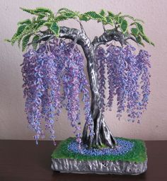 Beaded Wire Wisteria is an incredibly luxurious tree.Wisteria woven from beads is an incredibly luxurious tree. Our master class will inspire you to new ideas Seed Bead Flowers, French Beaded Flowers, Wire Flowers, Beaded Flowers Patterns, Beading Patterns, Beaded Crafts, Wire Crafts, Wisteria Tree, Wisteria Wedding