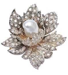 An antique french diamond brooch with pearl