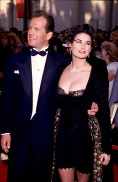 Click through the gallery to see 12 celebrity couples — including Bruce Willis and Demi Moore, Richard Gere and Cindy Crawford and more! — who got married in Sin City! Demi Moore, Emma Heming, Cute Celebrity Couples, Celebrity Weddings, Celebrity Babies, Brad Pitt, Floral Bustier, Bustier Dress, Ashton Kutcher