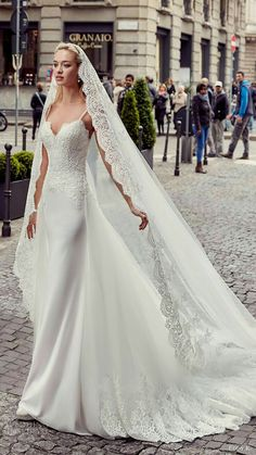 [This is one of the nicest gown and veil sets I've seen. I like the way the edging on the veil matches the hem of the train.  And the great thing about making the dress ourselves is that we can make the veil too, if she chooses to wear one.]   That veil!!!!!!!