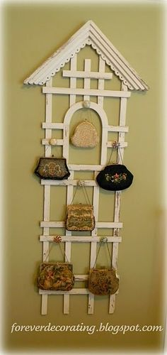 Trellis, glass knobs.  Use for necklaces, belts, scarves, etc.  @Jennifer Williams, you could something like this for your old purses.