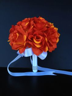 Color:. Dark orange Artificial Flower Bouquet Orange open roses. Measurement: 8 x 8 x 8 Handle: whiteåÊribbon and bling. Ribbon color can be changed upon request.