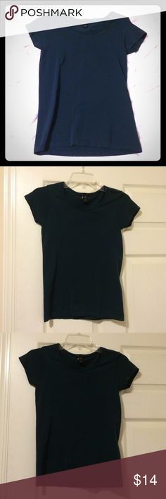 "Banana Republic Stretch top Banana Republic form fitting short sleeve, crew neck top. Deep blue/green color. 92% nylon, 8% spandex. Good condition - preloved but no stains, fading. L- 22"", W- 13"" pit to pit. Material stretches for form fitting, flattering look. Banana Republic Tops Blouses"