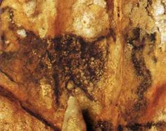 """Painting in the Grotte de Villars known as """"The Sorcerer and the Bison""""  This is one of the few known paintings of the human form in prehistoric european art."""