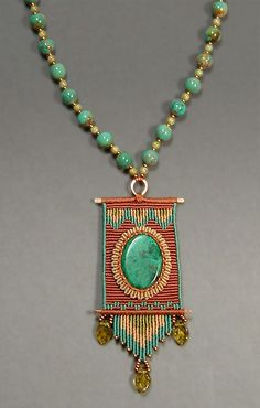 by Joan Babcock, Nylon Cord, Turquoise and Glass Beads, Azurite Cabochon, Brass.