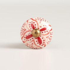One of my favorite discoveries at WorldMarket.com: Red Basic Ceramic Floral Knobs, Set of 2