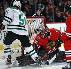 CHICAGO, IL - FEBRUARY 11: Corey Crawford #50 of the Chicago Blackhawks makes a save against Tyler Seguin #91 of the Dallas Stars at the United Center on February 11, 2016 in Chicago, Illinois. (Photo by Jonathan Daniel/Getty Images)