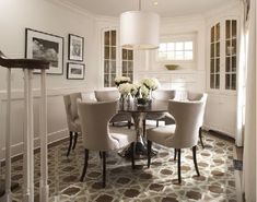 Luxury Dining Room Design with Modern Pendant Light above Round ...