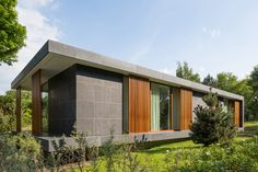 Architecture firm BERG + KLEIN, have designed a new villa in Hoek van Holland, The Netherlands, that combines concrete, wood and natural stone to create a modern facade. Wood Architecture, Concrete Wood, Home Design Plans, Netherlands, House Design, House Styles, Loft, Landscape, Create