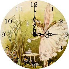 Love this vintage fairy clock