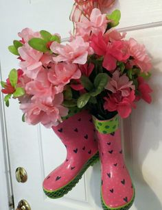 How cute it that..rubber rain boots with flowers on the front door