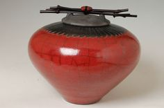 """Medium Raku Feather Urn 11.5""""W x 8.75″H; 410 cubic inches volume The medium raku urn makes a good gift item or accent piece, this size will fit into any home's decor. The raku urns were inspired by the many fine examples of primitive ritual and ceremonial ceramics from around the world. Secure flange lid stays put unless turned upside down. Adorned with black bamboo & Zuni inspired gemstone bear fetish held in place w/ sinew. Available in 7 sizes and 15 colors."""