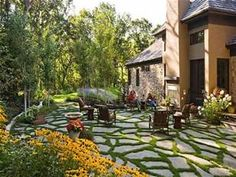 Backyard Ideas On A Budget - Love the stone and grass together! Looks low maintenance but very classy