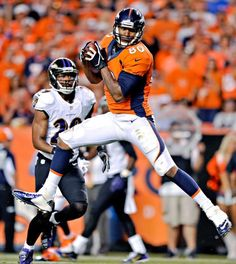 Denver Broncos tight end Julius Thomas (80) pulls in a pass that he ran in for a touchdown as Baltimore Ravens free safety Michael Huff (29) defends during the first half. (Jack Dempsey/AP)