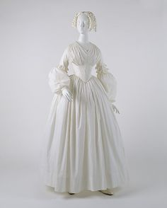 Dress  Date: ca. 1840 Culture: American Medium: cotton Dimensions: Length at CB: 51 1/4 in. (130.2 cm) Credit Line: Gift of Richard Martin and Harold Koda, in honor of Cora Ginsburg, 1993 Accession Number: 1993.32