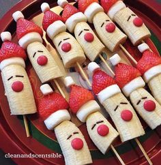 Christmas bananas on a stick. Add marshmallows and strawberries to your banana pop and serve them as treats to guests.