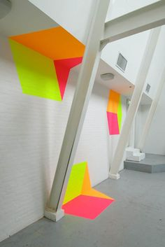 Dutch artist Henriëtte van 't Hoog's installations look 3D, but are completely flat. She uses trompe l'oeil to give her work depth, designing space in a way so that our eye is fooled. To do so, she uses geometry and specifically placed and angled shapes, sometimes building out of the wall to create more complex structures.