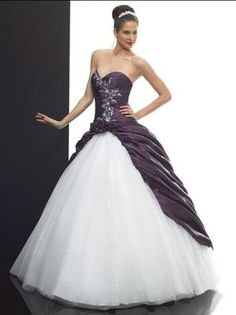 This is a perfect dress for my second and last wedding. I think its gorgeous, and the purple in it would be somthing the girls would,nt have a problem wearing.  This reminds me of that Cinderella dress every little girl dreamed of.