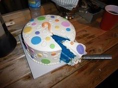 """cutest baby shower cake idea ever! It's a """"reveal cake"""" The expecting mother will give the bakery the letter stating whether its a girl or boy and the decorators will color the cake to reveal the gender at the shower."""