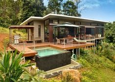 Nestled among 250 acres of rainforest, Crystal Creek Rainforest Retreat is secluded sanctuary ideal for romantic weekend getaway. Bungalow, Retreat House, Hillside House, House On Stilts, Container House Design, Tropical Houses, Small House Plans, Modern House Design, Future House