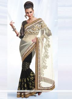 Its a master piece in its class glorifying your timeless beauty. Pamper the women in you with this beautiful black net designer saree. The embroidered and patch border work personifies the entire appe...