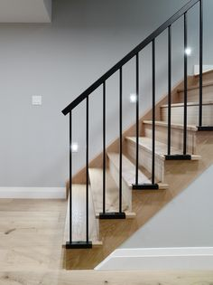 Contemporary basement for the whole family. The gas fireplace, recessed tv and custom furniture add … - Contemporary basement for the whole family. The gas fireplace, recessed tv and custom furniture add … - # Modern Stair Railing, Stair Railing Design, Staircase Railings, Modern Stairs, Open Staircase, Staircase Ideas, Banisters, Staircases, Iron Stair Railing