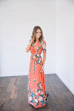 This Flower Patch Maxi Wrap Dress is a dream come true! The gorgeous floral print features beautiful pattern, deep greens and a touch of yellow. You will be looking for any excuse to show this wrap dress off. This dress is perfect for anything from a casual date night to a summer day event. Our wrap dresses are one of the most comfortable dresses you'll ever own. || Bella Ella Boutique Flower Patch Maxi Wrap Dress Bella Ella Boutique Online Store