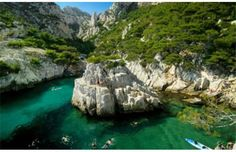 France's Calanque de Sugiton. A calanque is a geologic formation shaped like a deep valley with steep sides, typically made of limestone, and partially submerged by the sea.  This Mediterranean fjord is located between Marseille and Cassis in France, and is easily accessed on a hike.