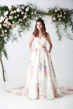 f142dd6adaaa0 ... gown from the Untamed Love collection in an exclusive floral bloom  fabric exclusive to the house of Charlotte Balbier The perfect floral  wedding gown.