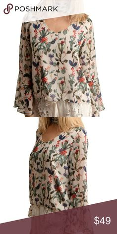 Walter Baker Karla Boho Blouse Floral print V neckline with the at back. Long sleeve with ruffle cuffs. Pullover style. Multihued print. Poly. Walter Baker Tops Blouses