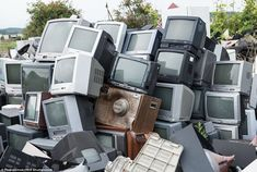 A stack of contaminated televisions lie in a heap among the overgrown forests and abandone...