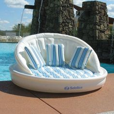 The AquaSofa is an oversized, floating lounger that is super comfortable and covered in fabric with a wrap-around back rest and large enough for three adults.