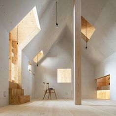 An Ercol stacking chair in the Ant House by mA-style architects, Japan. The entire interior of the house is made of plywood, with a smaller house shaped structure inside.