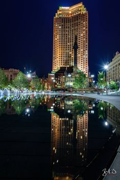 The Huntington Bank Building and its reflection in  Cleveland Public Square's fountains. #Cleveland #Ohio