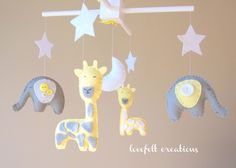Baby mobile - baby mobile - Elephant Mobile - Giraffe Mobile - Nursery Mobile - CUSTOMIZE....You can pick colors too :). $92.00, via Etsy.